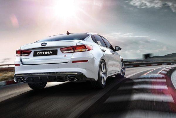 2019-Kia-Optima-S-in-white-racing-down-track